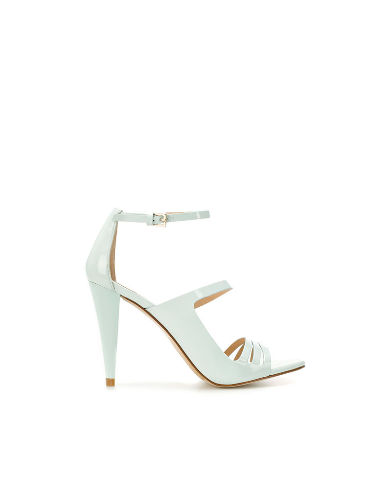 The subtle pastel hue and patent sheen would give your look just a touch of seasonal-chic.  Zara Sandal With Ankle Straps ($100)
