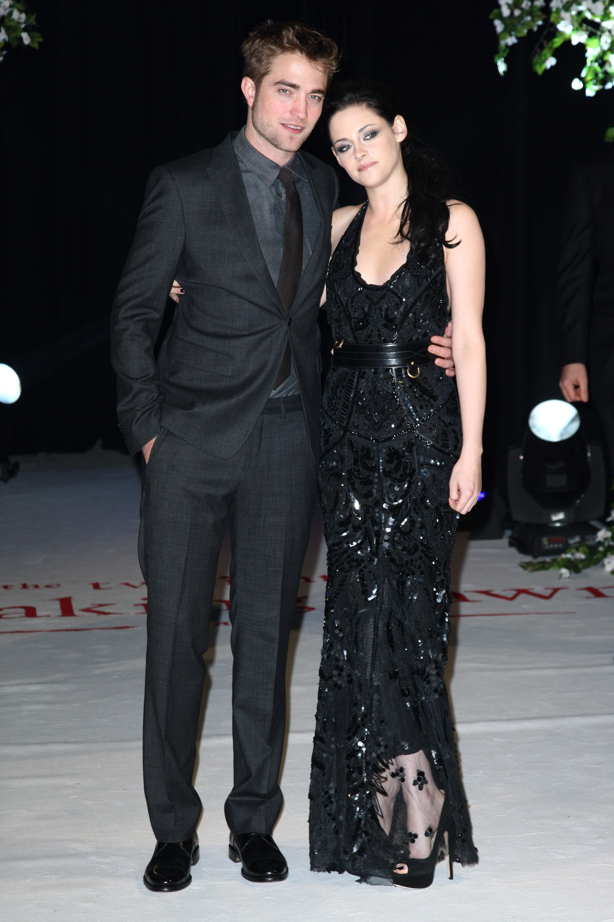 Kristen Stewart posed with Robert Pattinson at the UK premiere of Breaking Dawn Part 1 at Westfield Stratford City in November 2011.