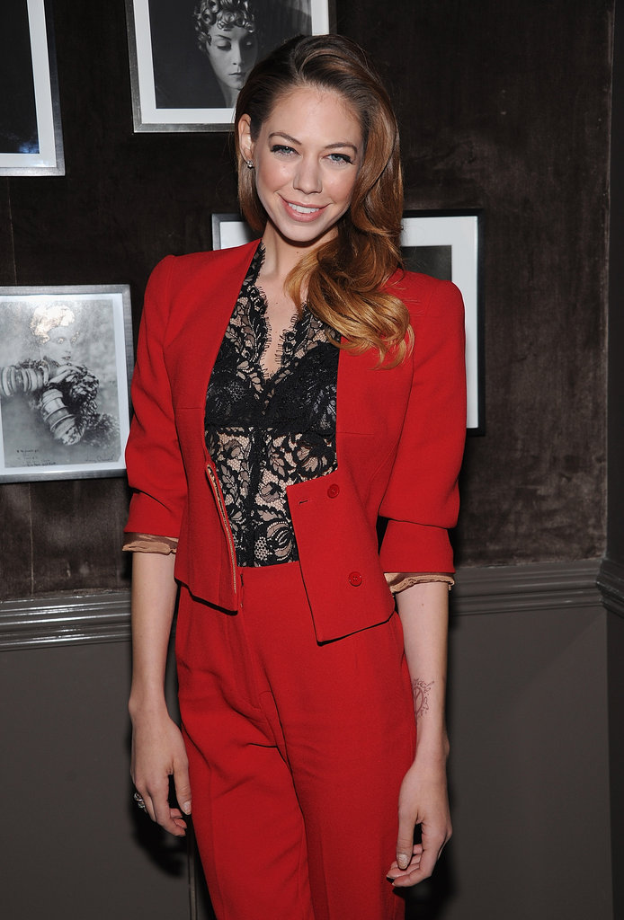 Analeigh Tipton wore a red pant suit with a sexy black shirt to a private dinner for Elie Saab in NYC.