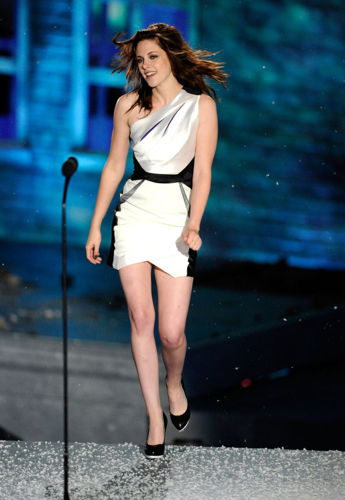 Kristen Stewart gave a sexy hair toss as she accepted one of her two Scream Awards in October 2010.