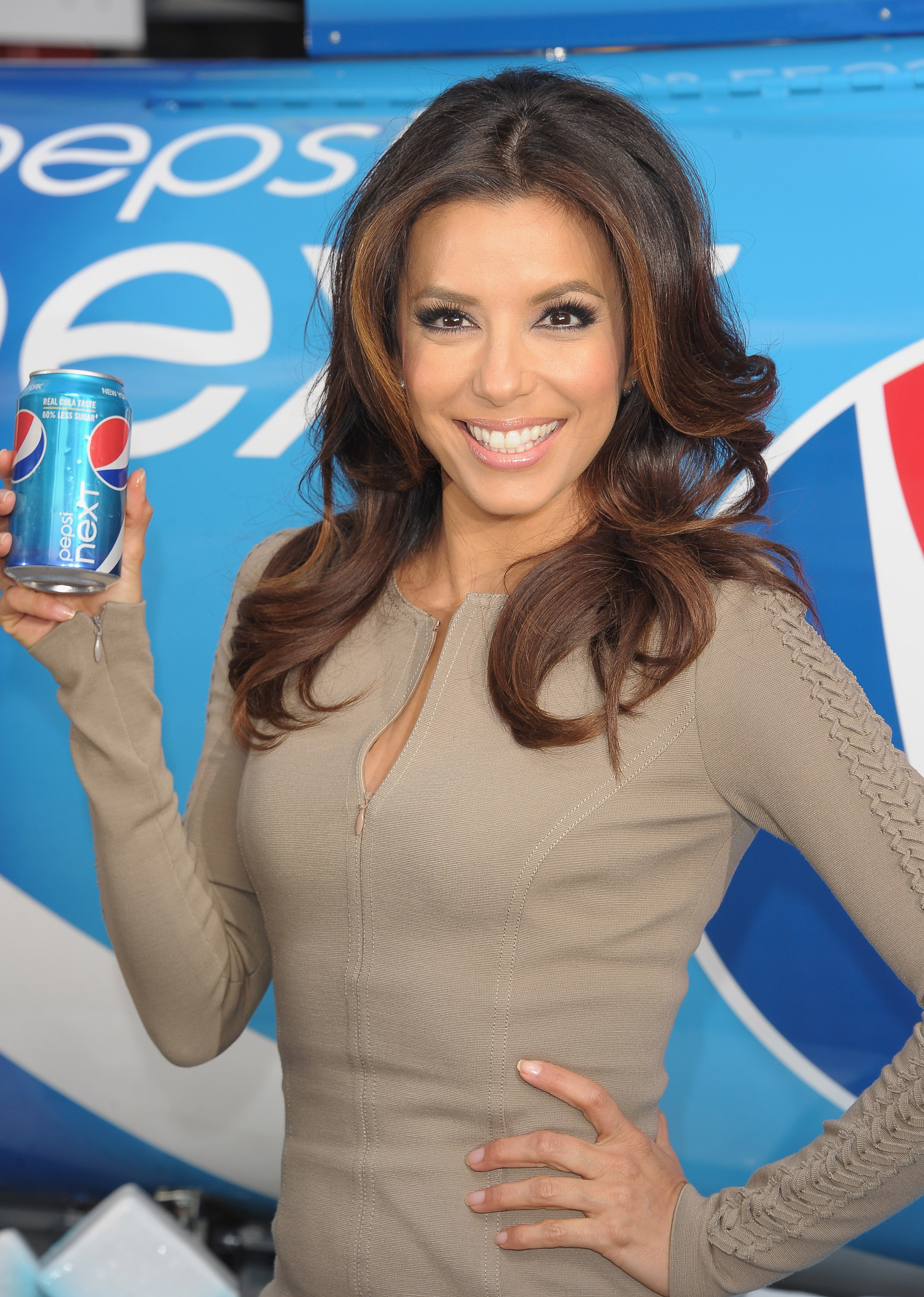 Eva Longoria posed for a photo with a can of Pepsi Next in NYC.