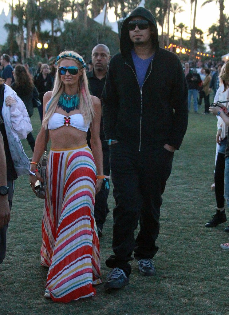 Paris Hilton and her boyfriend, DJ Afrojack, hung out at Coachella on Saturday before partying at Neon Carnival late into the night in 2012.