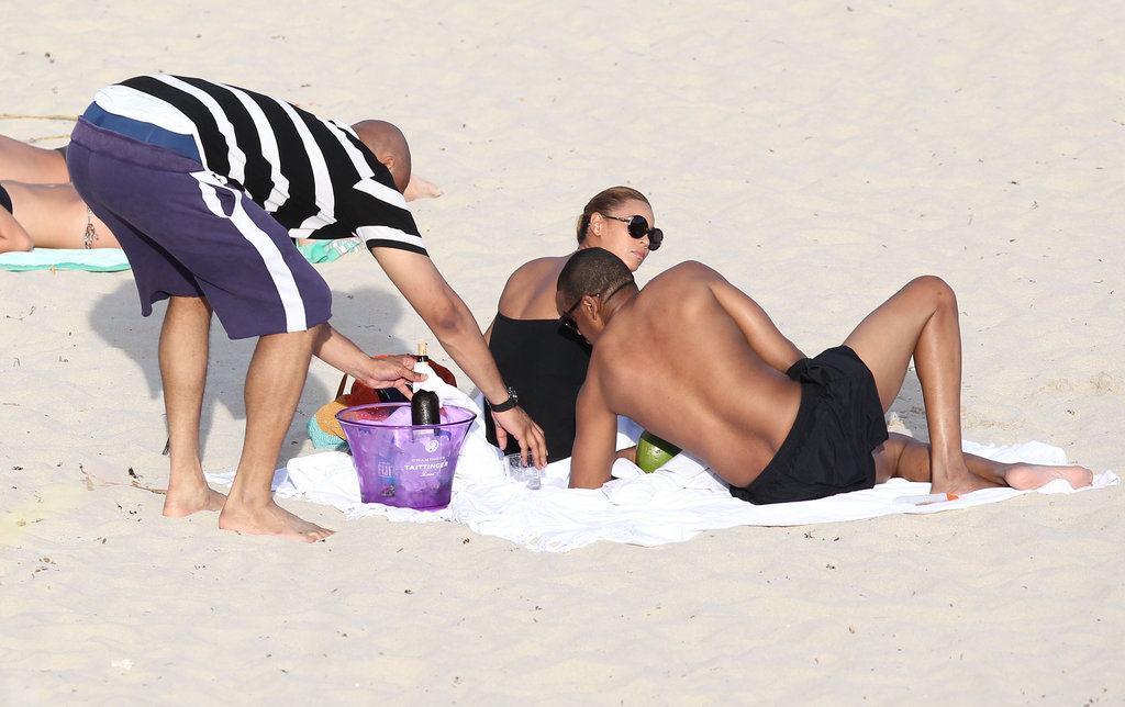 Beyoncé and shirtless Jay-Z hung out on the beach.