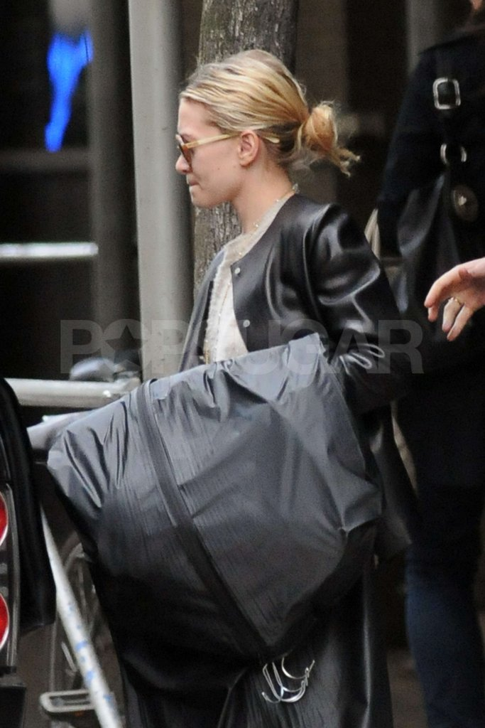 Ashley Olsen carried a garment bag to a car after shopping in the West Village.