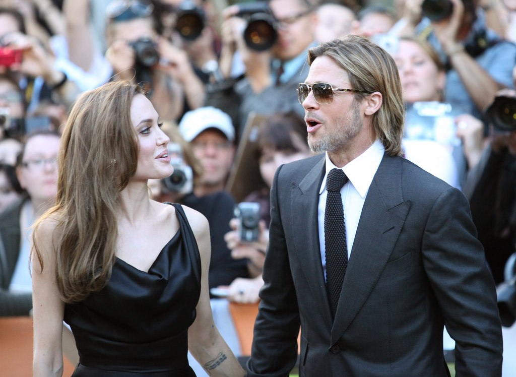 Brad Pitt and Angelina Jolie took in the scene at his September 2011 Toronto Moneyball premiere.