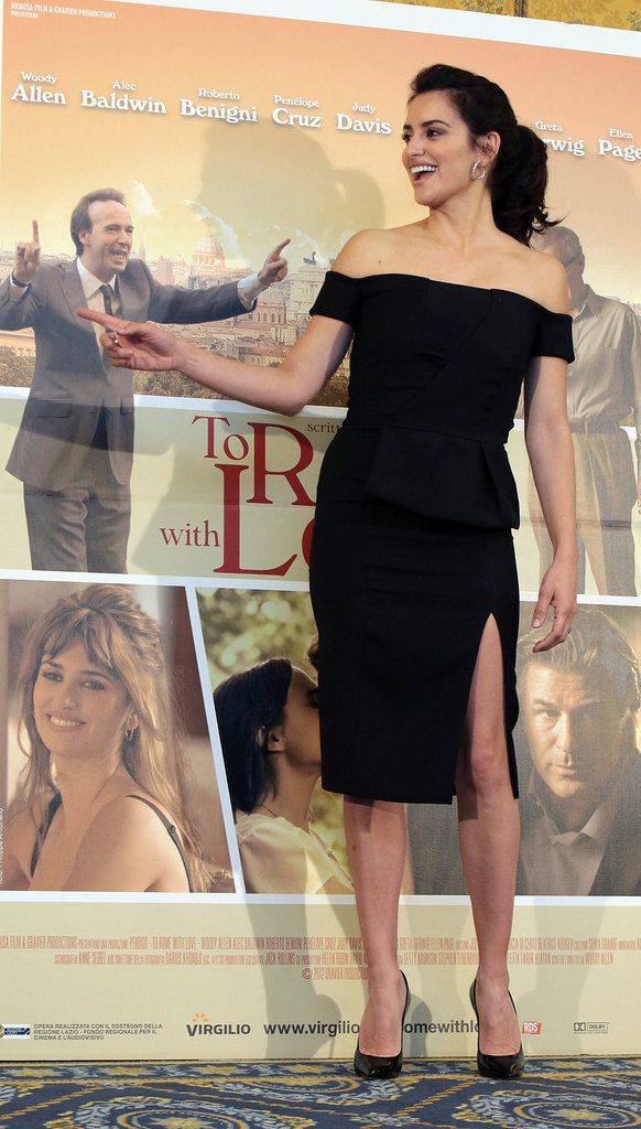 Penelope Cruz was all smiles as she posed with the To Rome With Love Poster.