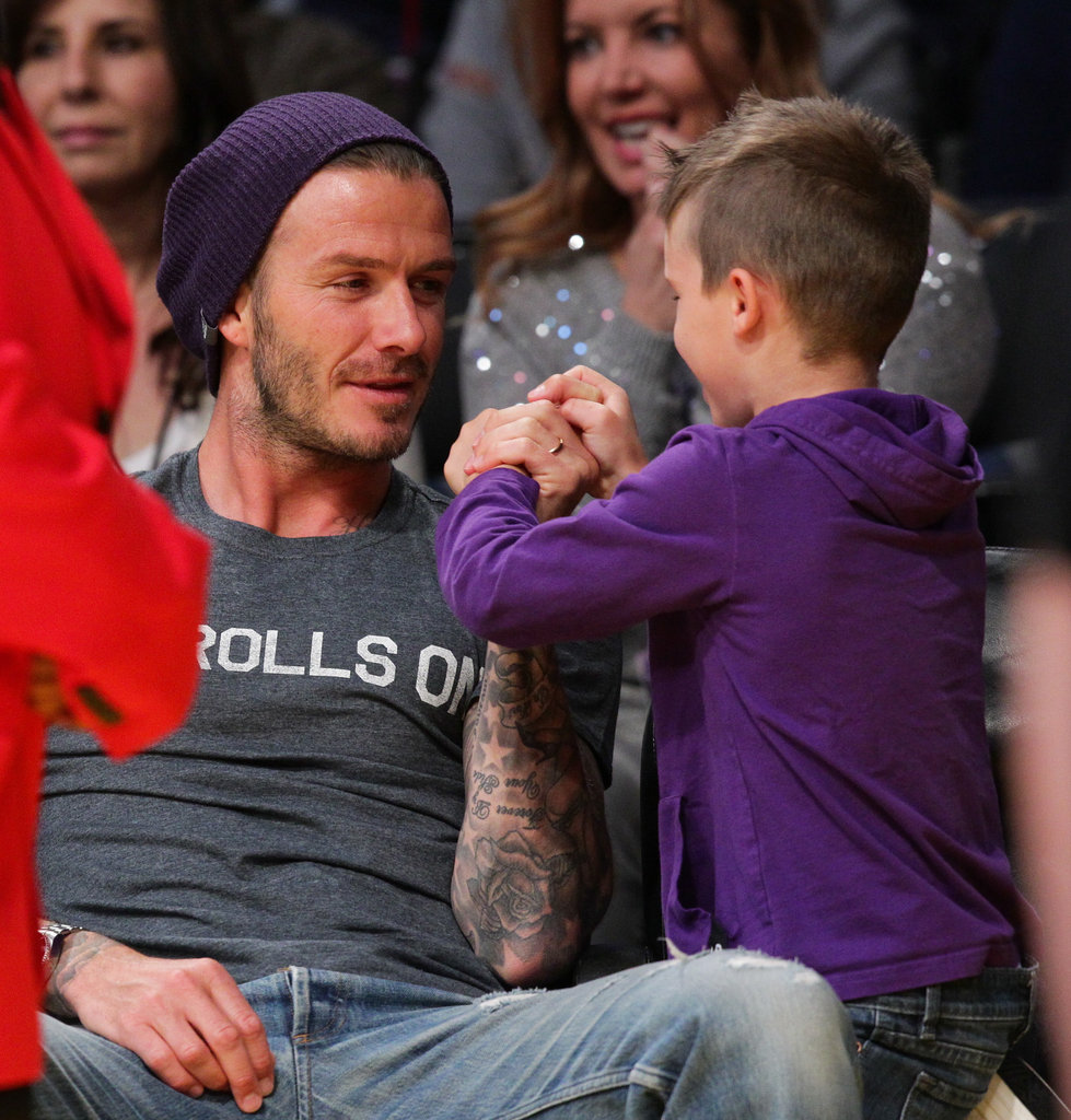 David Beckham had a laugh with Cruz Beckham at the Lakers game in LA.