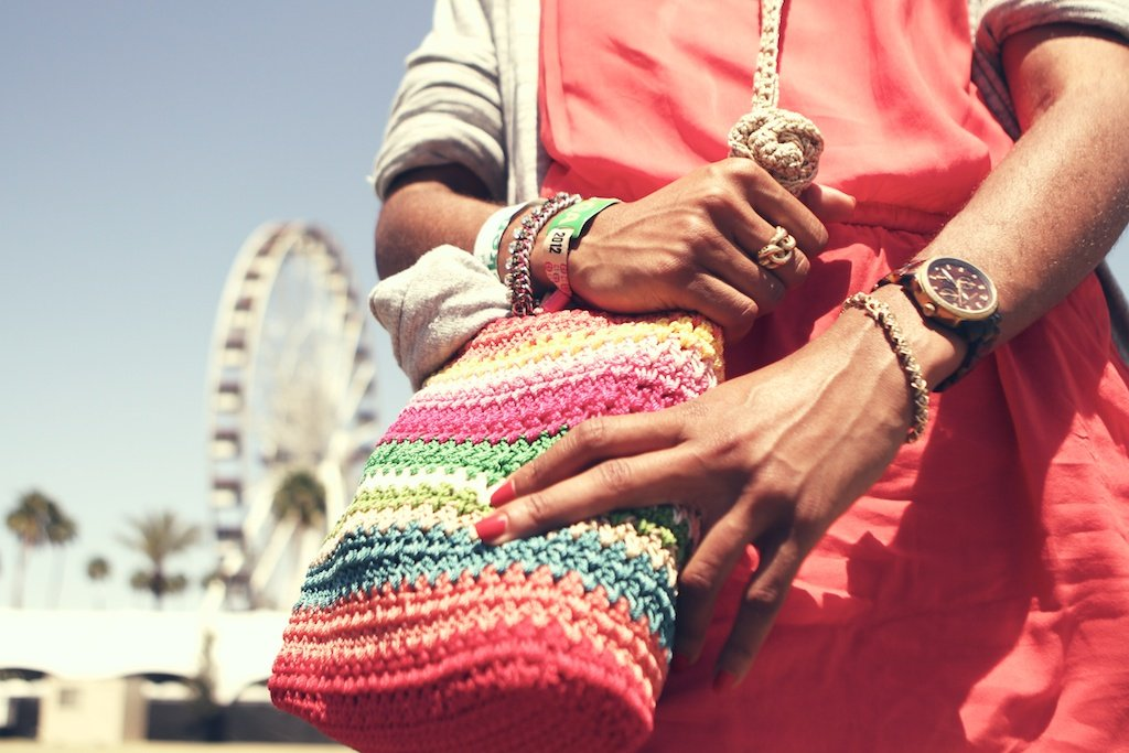 This cute and colorful woven bag is ideal for adding an extra bright pop  to any festival look.