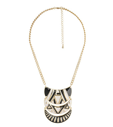 Accessories are the easiest way to add a tribal pop to your Spring look. The tiered crescent pendant necklace can easily be styled with LBDs for a standout look. Forever 21 Tribal Pendant Necklace ($9)