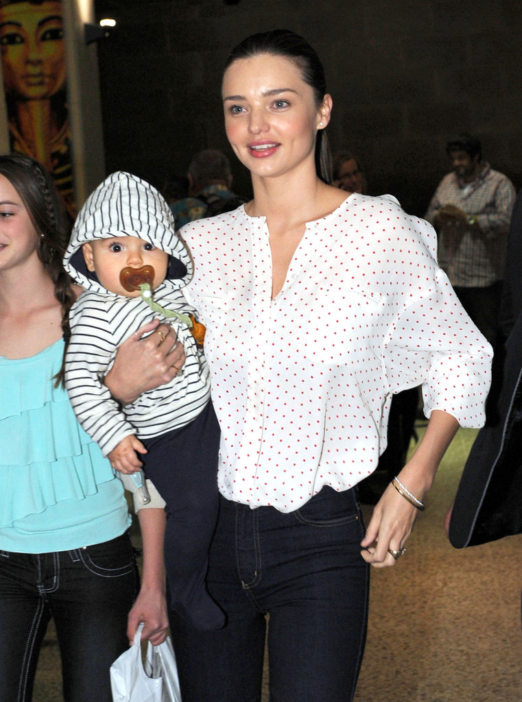 Flynn Bloom kept himself occupied with a pacifier while Miranda Kerr looked for their luggage during their August 2011 visit to Melbourne.