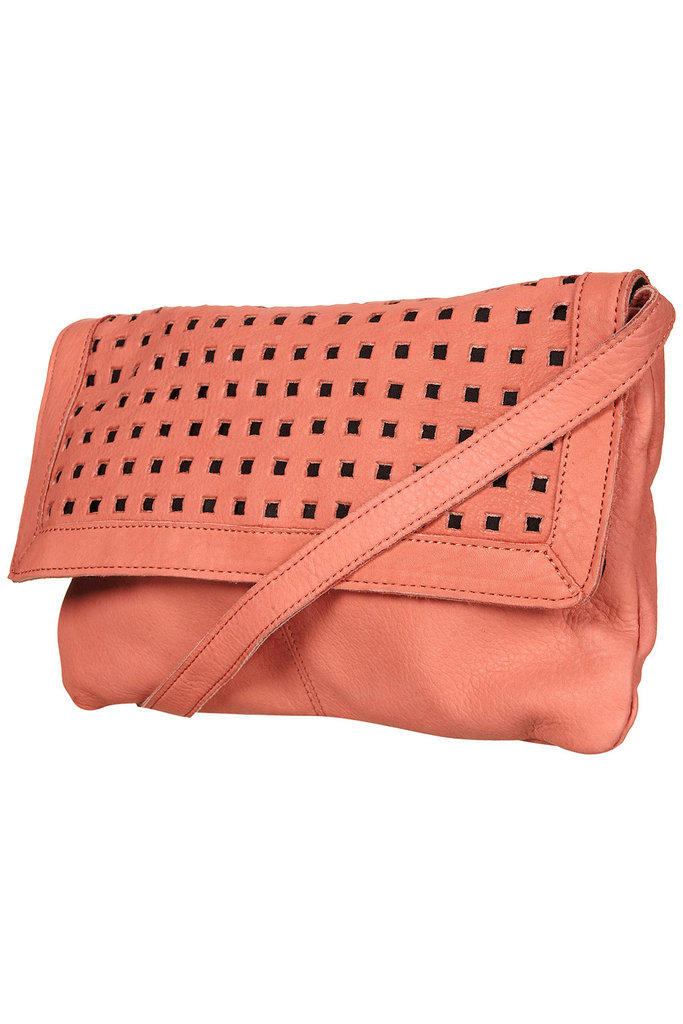 Soft coral coloring and magnetic fastening make this a no-fuss grab and go bag.  Topshop Leather Punchout Crossbody Bag ($70)