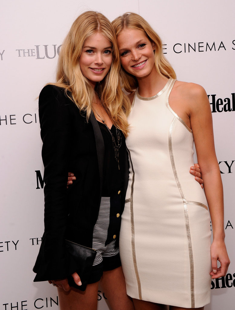 Doutzen Kroes and Erin Heatherton got close at  the Cinema Society and Men's Health screening of The Lucky One in NYC.