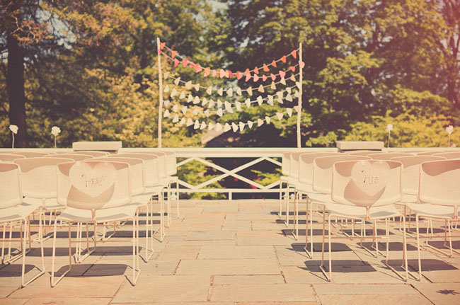 Delve into the popular ombré trend with layers of colored bunting in a variety of shades — simple, festive, and totally original. Photo by Sweet Little Photographs via Green Wedding Shoes