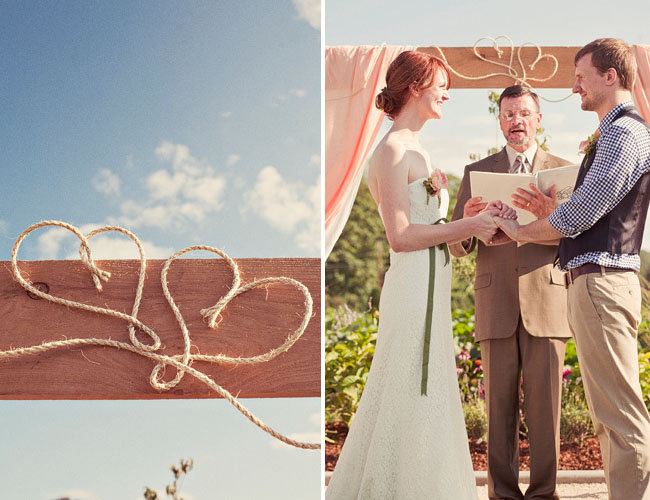 Although it's simple, the added touch of hearts on the archway makes the setting all the more special. Photos by Jagger Photography via Green Weddings Shoes