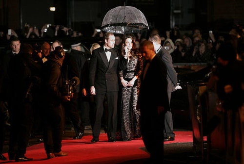 Prince William held the umbrella for Kate at the War Horse premiere in 2012.