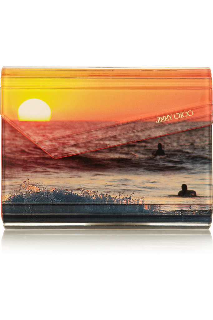 """""""I love the idea of infusing a bold pop of color with a standout print, especially one consisting of a beautiful beach sunset. This clutch will have you loving long Summer days right into Fall."""" — Allison McNamara, FabTV host and producer  Jimmy Choo Candy Acrylic Clutch ($795)"""