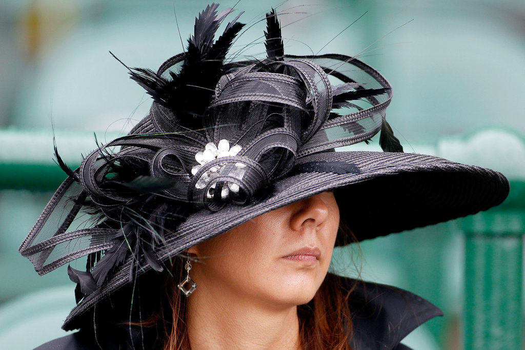A woman sported a black hat with lots going on in 2010.