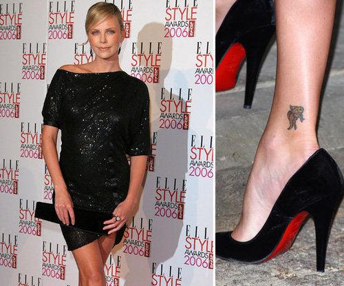 Charlize Theron and her mom got matching koi fish tattoos in 1991 —  the ink on her back right ankle is the Japanese symbol of love.