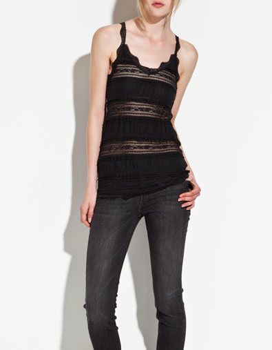 Scalloped edges and sheer lace panels make this romantic tank ideal for Summer date nights.  Zara Lace T-Shirt ($26)
