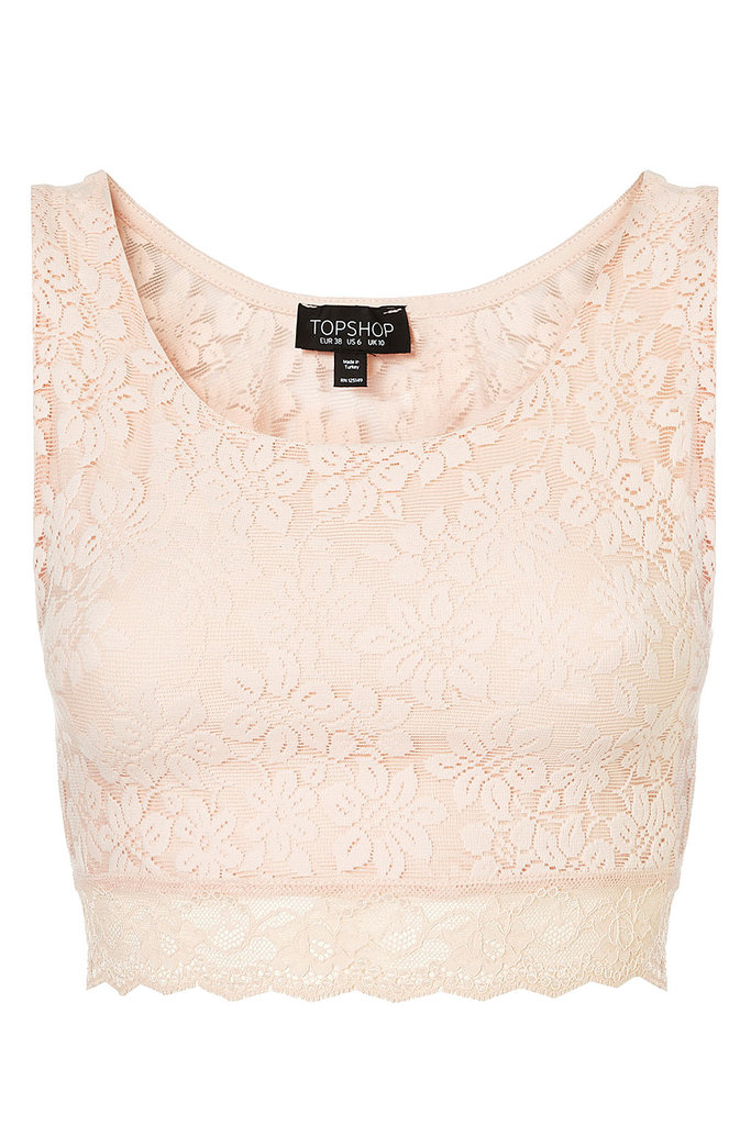 Blush pink lace looks fresh and unexpected in a cropped cut.  Topshop Lace Crop Tee ($28)