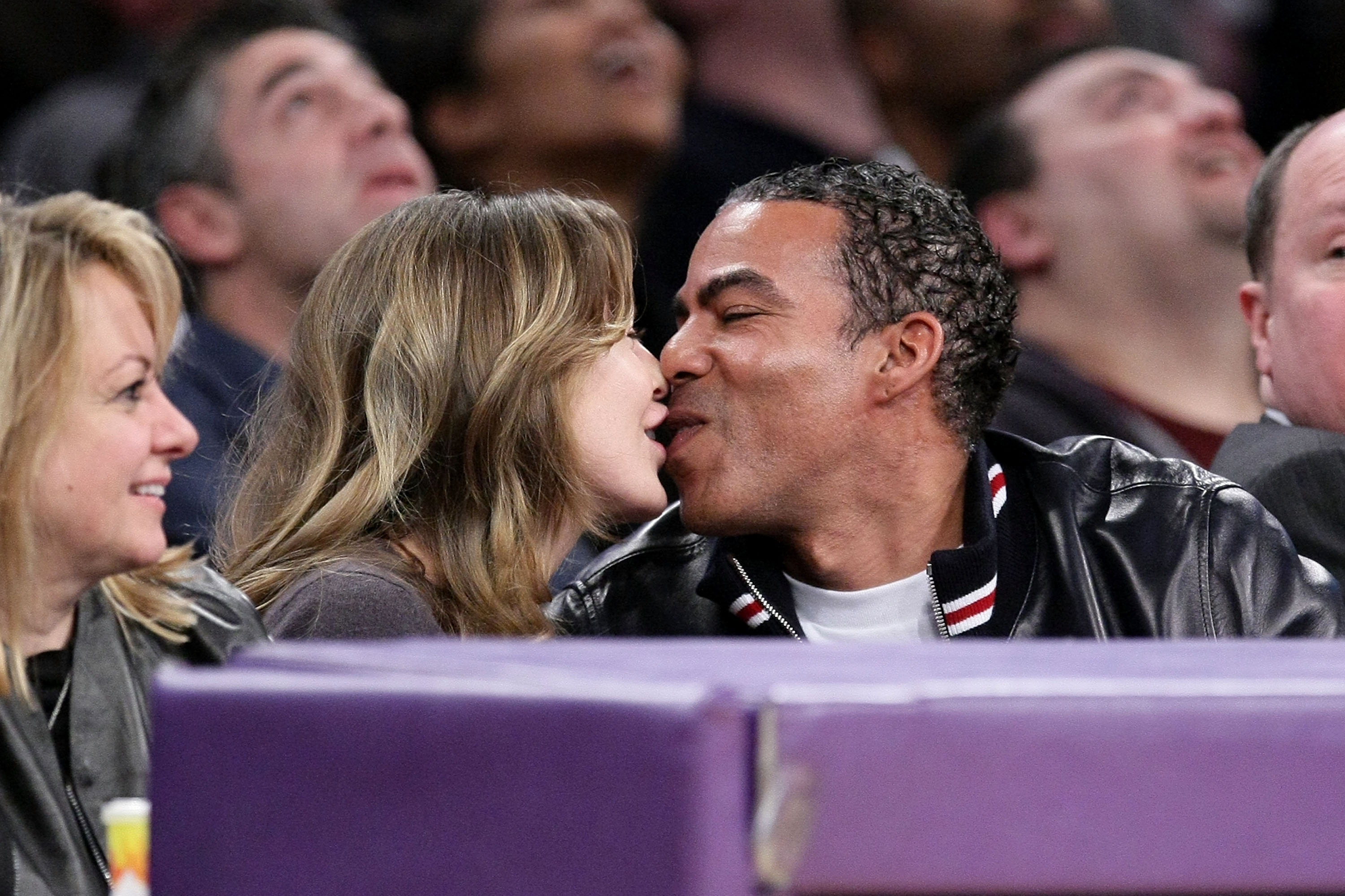 Ellen Pompeo and Chris Ivery locked lips at at Lakers game.