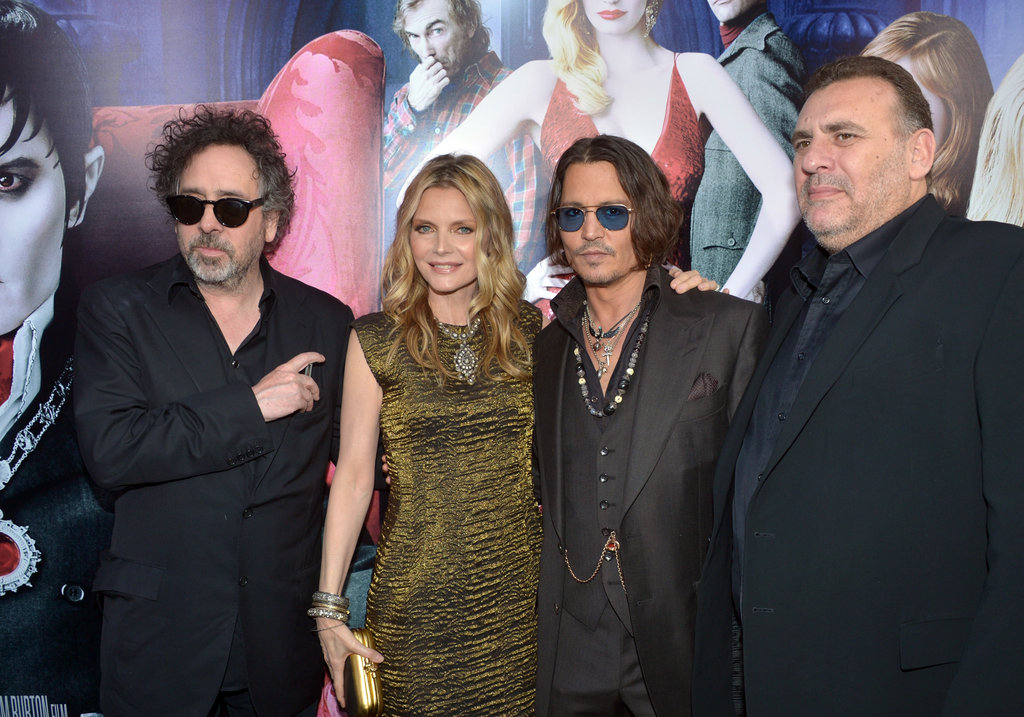 Director Tim Burton and producer Graham King posed with Michelle Pfeiffer and Johnny Depp for the Dark Shadows premiere in LA.