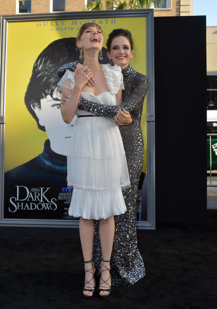 Bella Heathcote and Eva Green cracked each other up on the black carpet of the LA premiere of Dark Shadows.