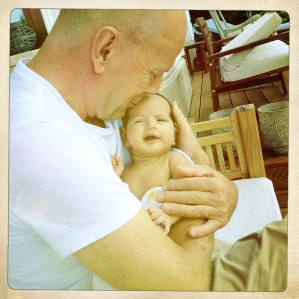 """Bruce Willis and Emma Heming waited until baby Mabel was 6 weeks old before sharing her photo via Emma's Twitter account. The proud mama tweeted, """"A beautiful day in Budapest with the loves of my life. Daddy and Mabel cracking each other up!"""""""