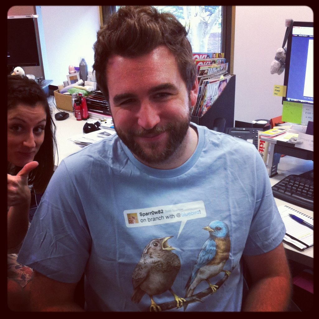 Our tech guru and designer Ben got a new delivery of Threadless tees and wore this Twitter one straight away. (Spot the photo bomber.)