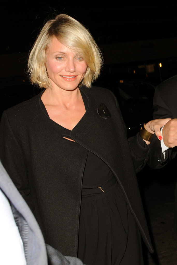 Cameron Diaz wore a black coat over her dress in NYC.
