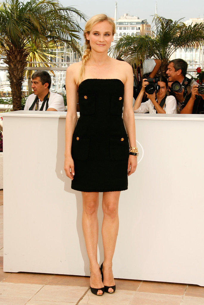 She posed in a vintage Chanel gold button-embellished LBD and black peep-toe pumps at the 2009 Inglourious Basterds photocall.