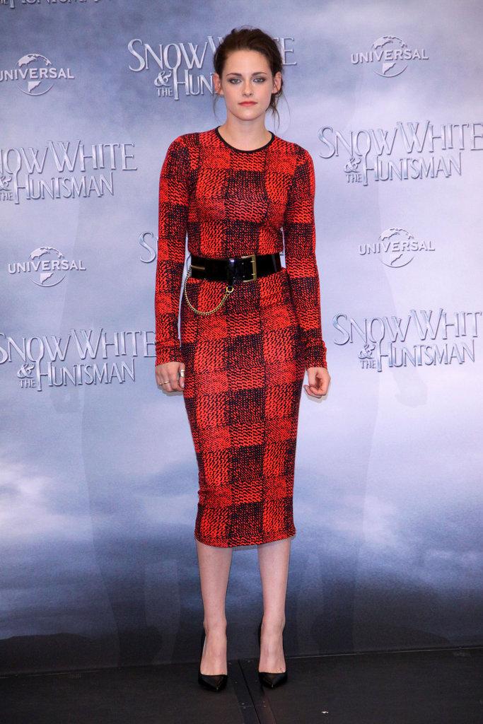 Kristen Stewart took the sophisticated angle in a calf-length 10 Crosby Derek Lam long-sleeved, printed sheath.