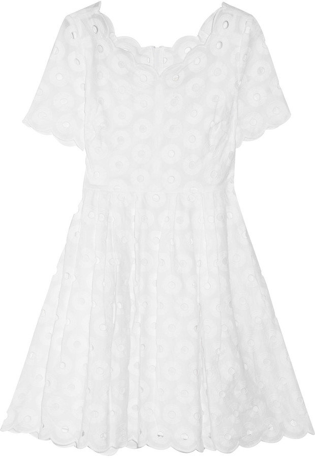 We'd style this sweet dress with a brightly colored statement necklace and cork-heel wedges.  J.Crew Eyelet-Embellished Cotton Dress ($230)