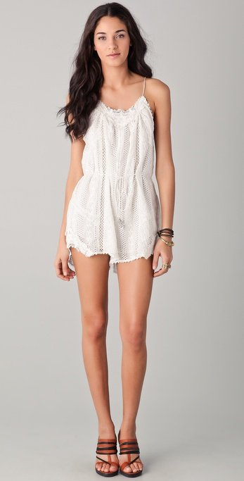There's nothing flirtier than a white eyelet romper.  Zimmermann Devoted Lace Playsuit ($395)