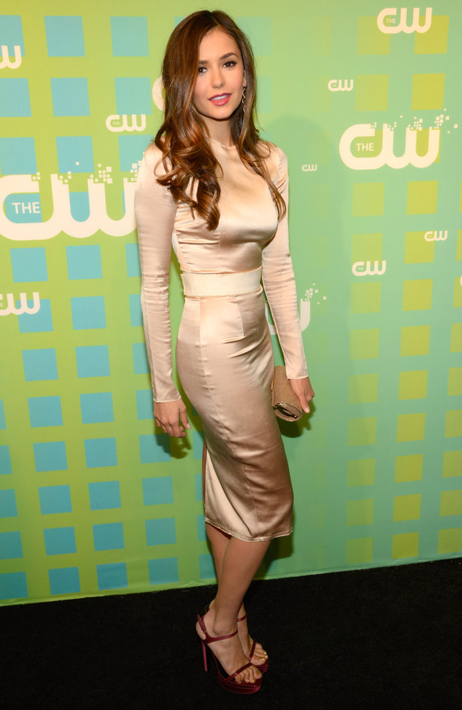Nina Dobrev paired her dress with a cute pair of heels.