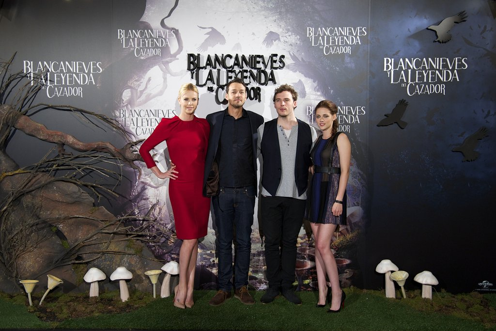 Costars Charlize Theron, Rupert Sanders, Sam Claflin, and Kristen Stewart posed together at the Snow White and the Huntsman photocall in Madrid.