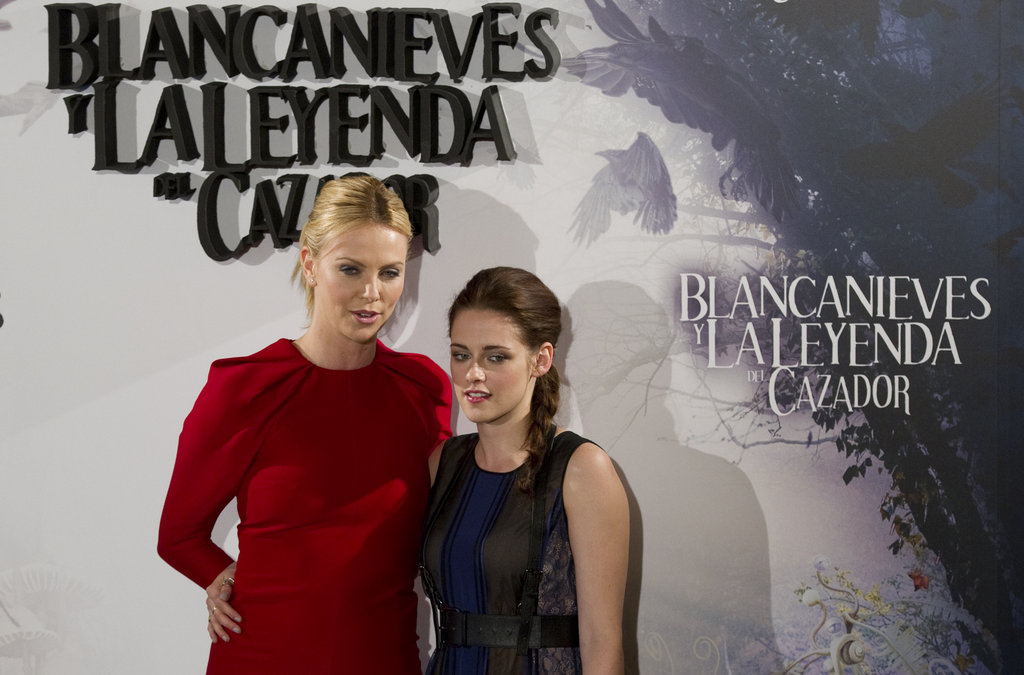 Charlize Theron and Kristen Stewart chatted together at the Snow White and the Huntsman photocall in Madrid.