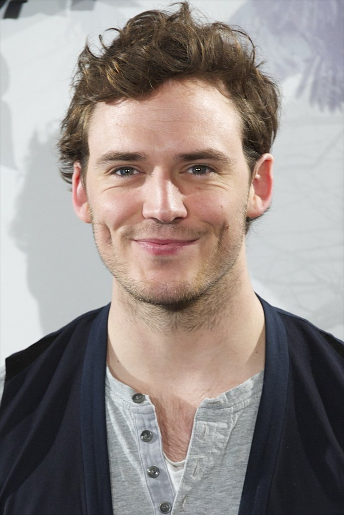 Sam Claflin gave a happy smiled at the Snow White and the Huntsman photocall in Madrid.