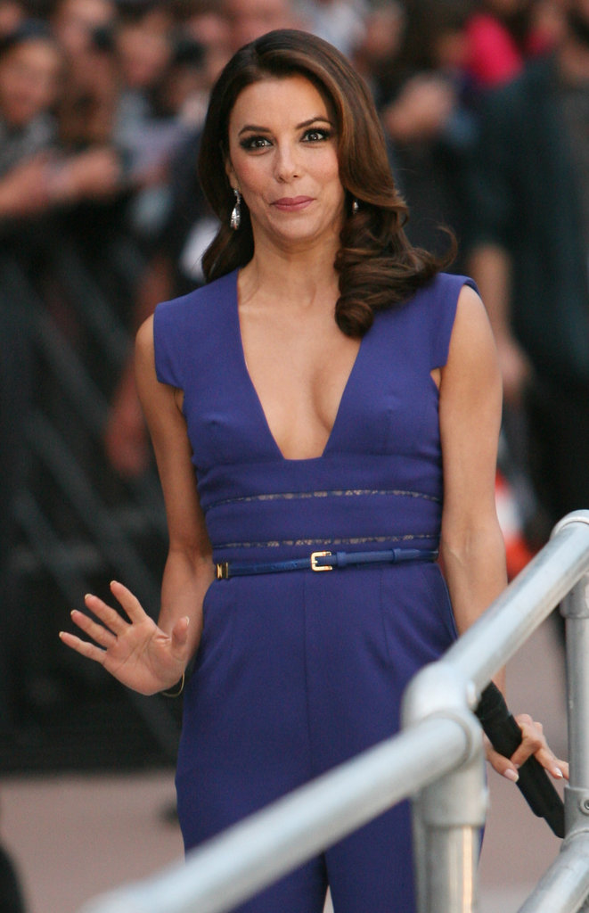 To offset her royal blue Elie Saab jumpsuit, Eva Longoria donned a muted blue leather belt at the waist.