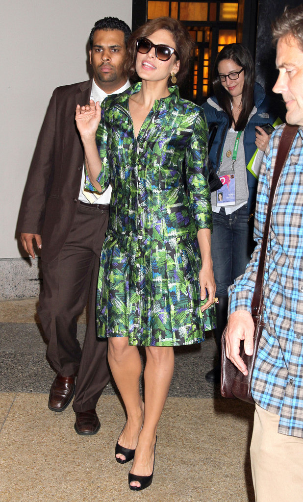 Eva paired her knee-length green-and-blue printed silk dress with black peep-toes and exaggerated cat-eye sunglasses, creating yet another signature look. 6935500