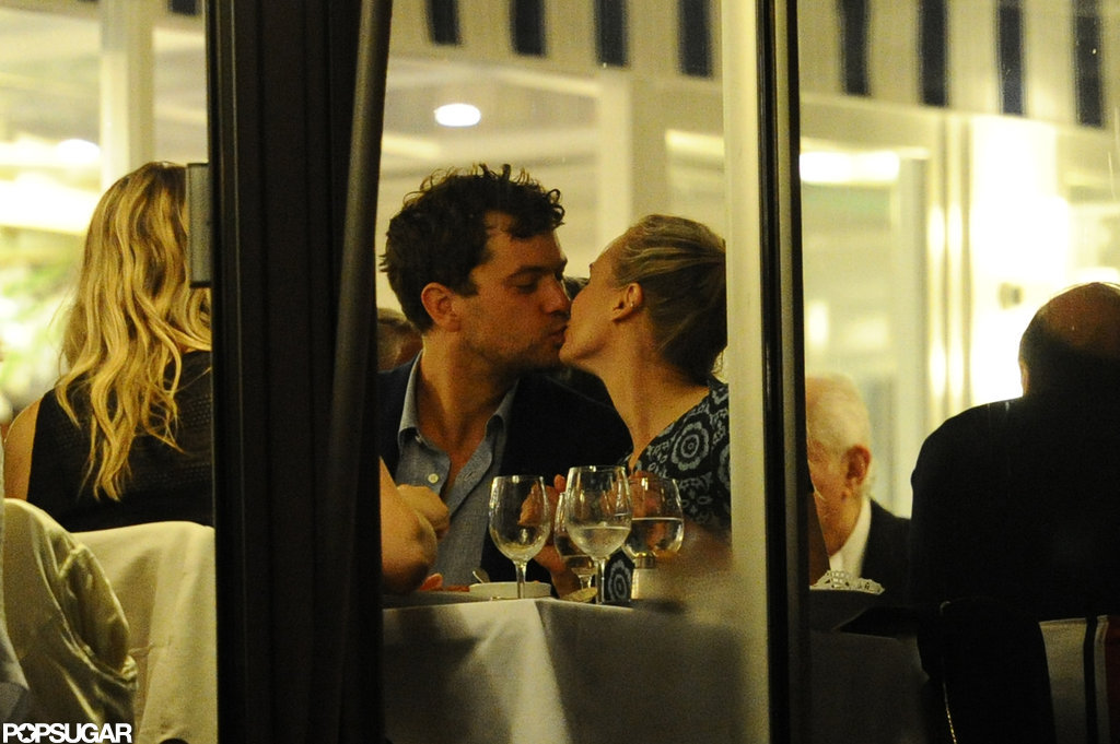 Diane Kruger and Joshua Jackson kissed while eating out in Cannes.