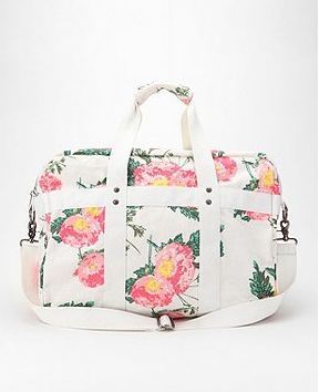 We're smitten with the fresh, floral-on-white print. Whether you're grabbing it for a weekend getaway, stashing your stuff for a day at the beach, or heading off to the gym, this style is sure to illicit lots of compliments.  Kimchi Blue Floral Patch Weekender Bag ($59)