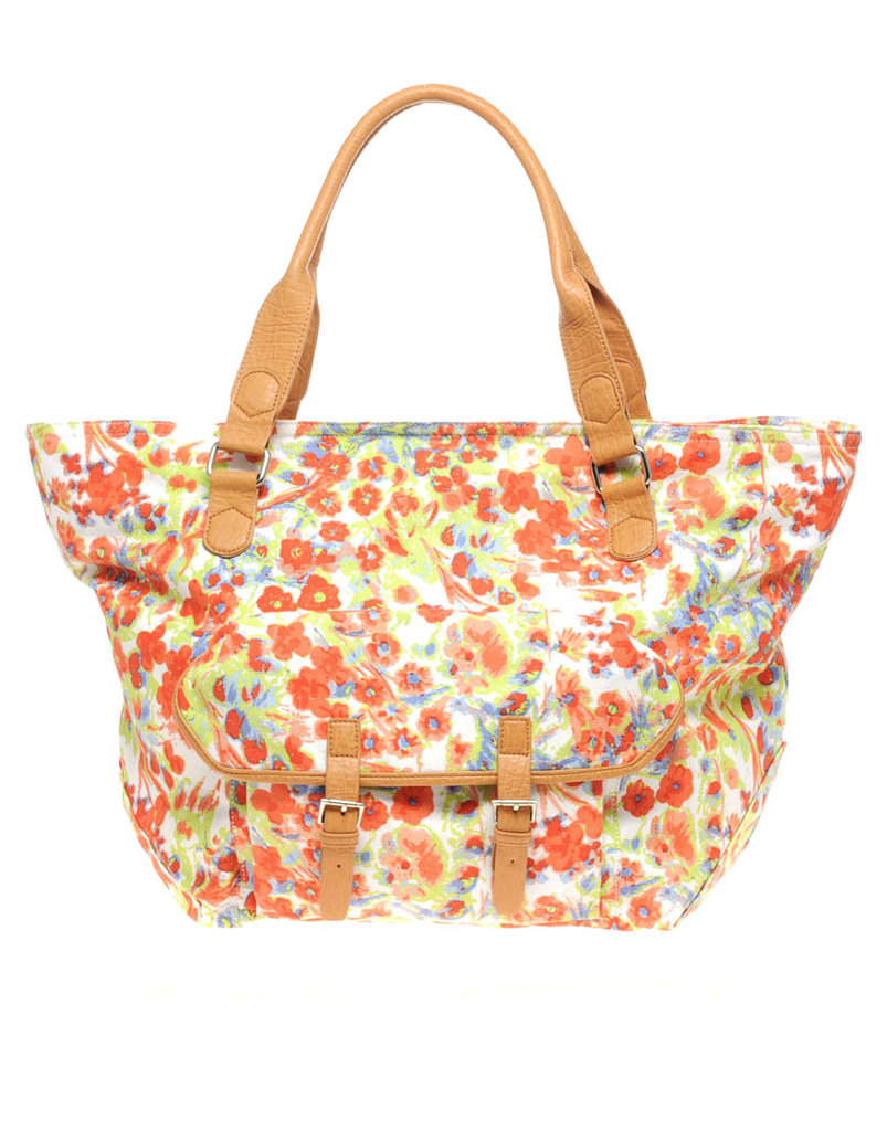 Inject a dose of seasonal florals into your look, wherever you may go.  Asos Floral Print Pocket Shopper Bag ($61)