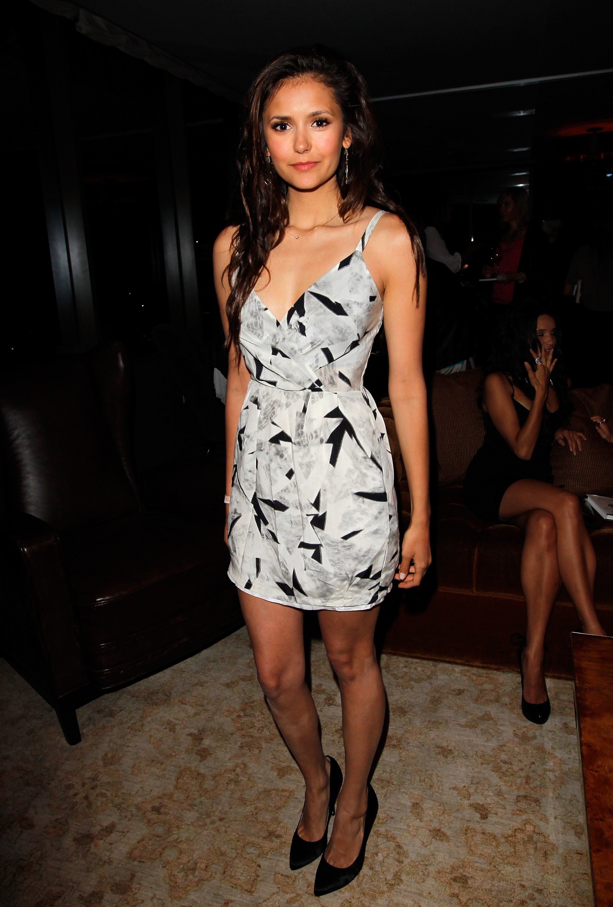She wore a graphic-printed minidress and black pointy-toe pumps for a Glamour party in April 2012.