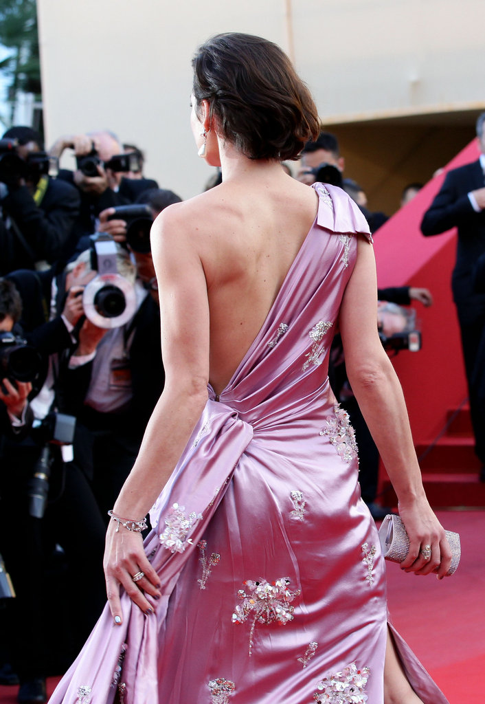 The asymmetric back and beautiful embellishments on Milla's gown.