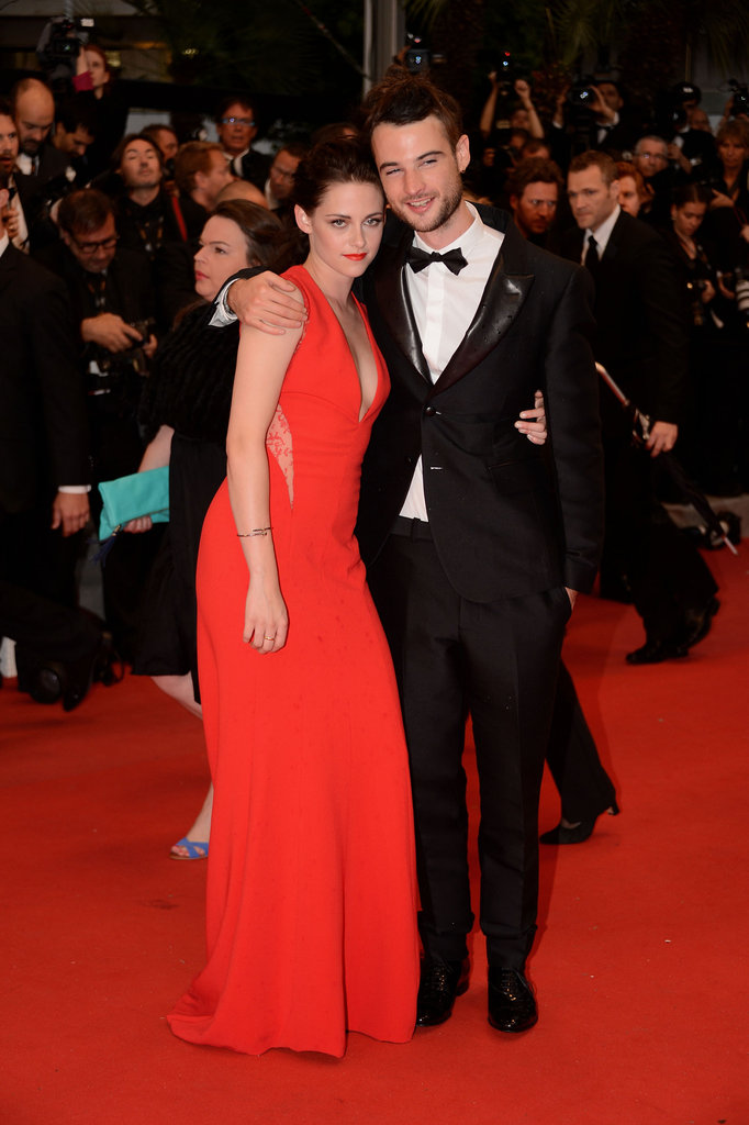 Kristen Stewart cuddled up to her On the Road co-star Tom Sturridge at the Cannes premiere of Robert Pattinson's film Cosmopolis on May 25.