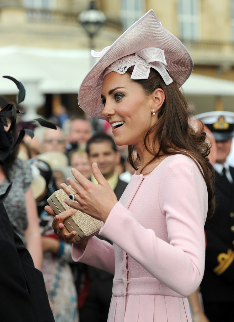 Kate Middleton spoke animatedly with a guest.