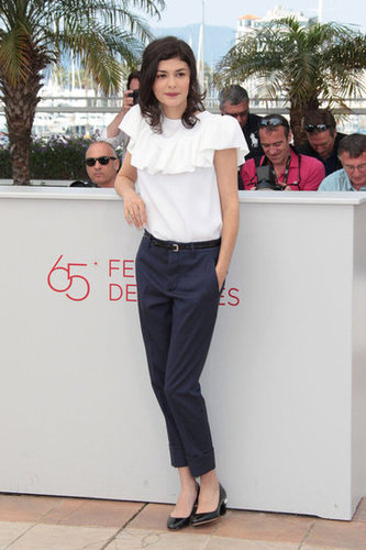 Audrey Tautou was the picture of Parisian-cool in cropped navy trousers, a white ruffled top, and low-heeled pumps at the Thérèse Desqueyroux photocall.
