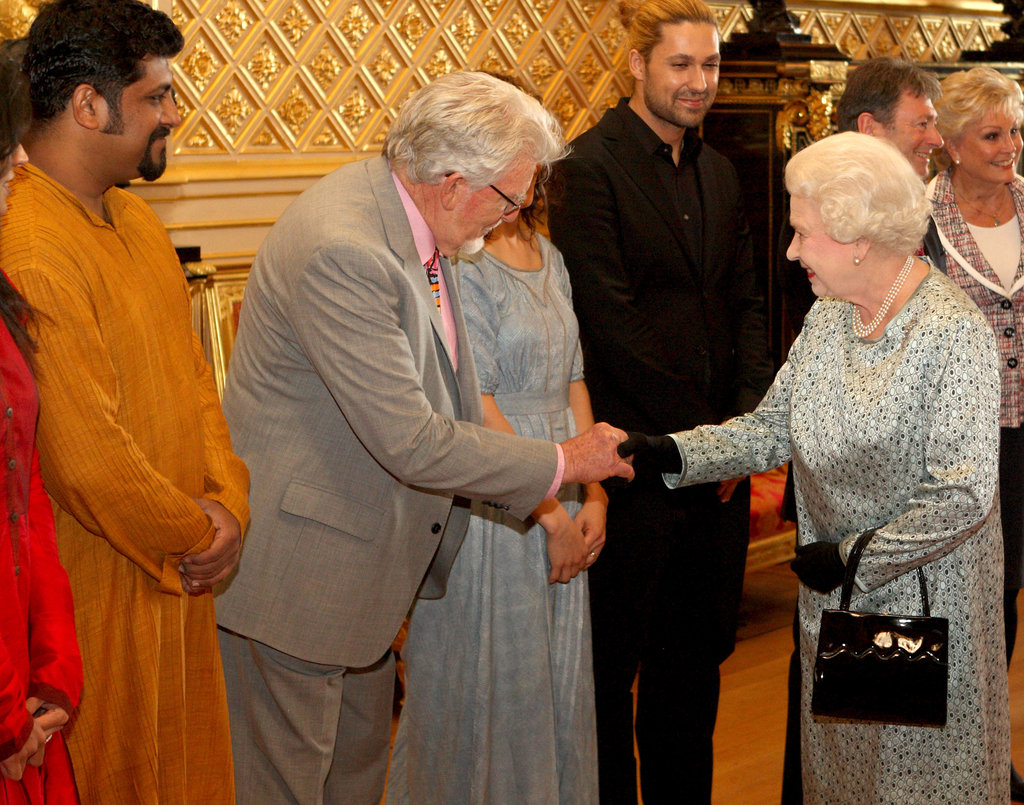 Queen Elizabeth II met Rolf Harris during a tea party for the cast of the Diamond Jubilee Pageant at Windsor Castle on May 11.