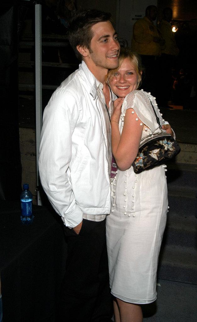 Jake Gyllenhaal embraced Kirsten Dunst backstage at the 2003 MTV Movie Awards.